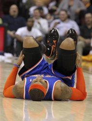 New York Knicks&#39; Carmelo Anthony lies on the court after injuring himself while falling at midcourt during the second quarter of their NBA basketball game against the Cleveland Cavaliers in Cleveland March 4, 2013. REUTERS/Aaron Josefczyk