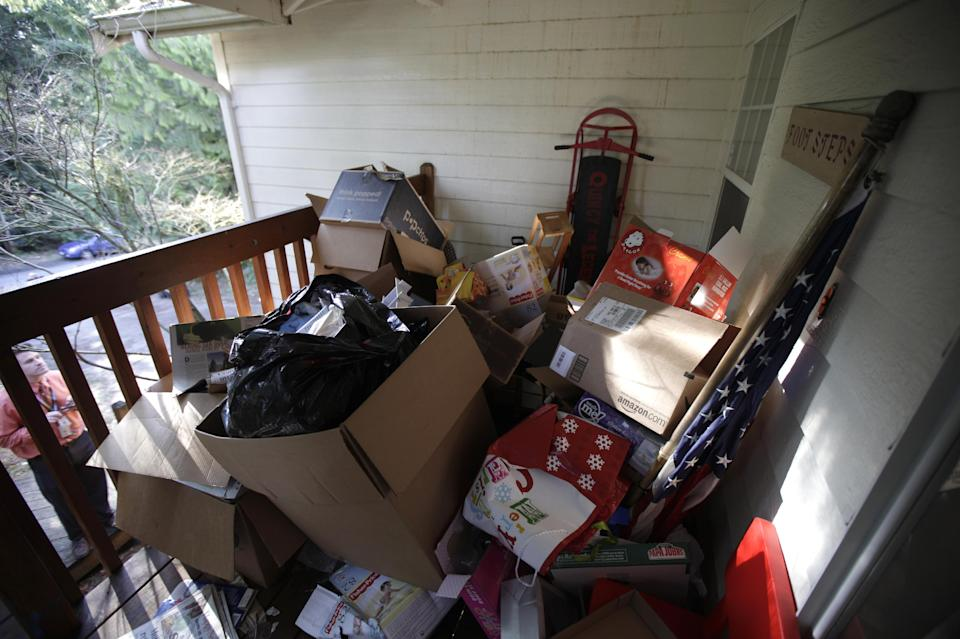 Boxes and a U.S. flag sit Friday, March 16, 2012, in Lake Tapps, Wash., on the front porch of the home of U.S. Army Staff Sgt. Robert Bales, who is accused of killing 16 Afghan civilians. (AP Photo/Ted S. Warren)