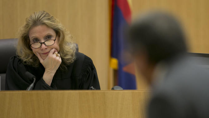 Judge Sherry Stephens listens to Prosecutor Juan Martinez during the Jodi Arias trial at Maricopa County Superior Court in Phoenix on Wednesday, Feb. 27, 2013. Arias is charged in the June 2008 death of her lover in his suburban Phoenix home. She says it was self-defense, but police say she planned the attack on Travis Alexander in a jealous rage. (AP Photo/The Arizona Republic, David Wallace, Pool)