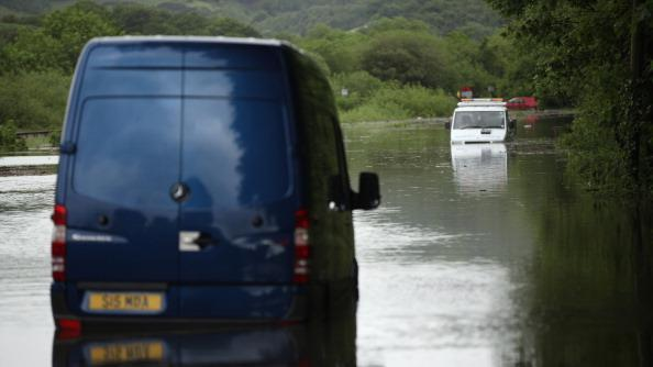 A breakdown truck is stranded in flood waters near the town Machynlleth on June 9, 2012 in Aberystwyth, Wales. Severe flooding has affected mid Wales with a major rescue operation under way taking to safety nearly 100 people so far. (Photo by Christopher Furlong/Getty Images)