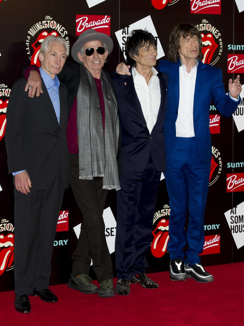 From left, Charlie Watts, Keith Richards, Ronnie Wood and Mick Jagger, from the British Rock band The Rolling Stones, arrive at a central London venue, to mark the 50th anniversary of the Rolling Stones first performance, Thursday, July 12, 2012. (AP Photo/Jonathan Short)