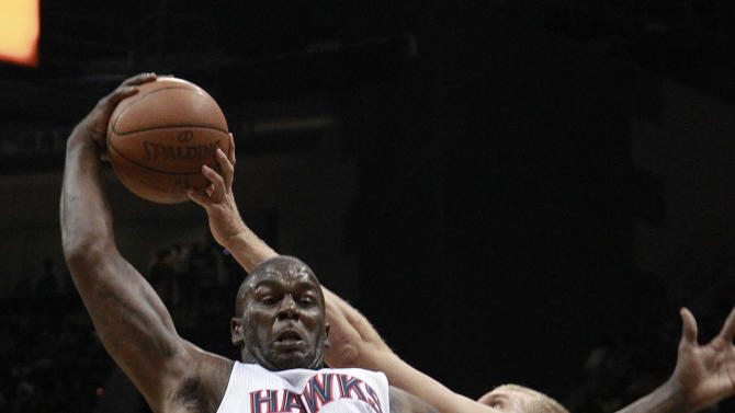 Atlanta Hawks forward Ivan Johnson (44) and Boston Celtics center Greg Stiemsma (54) vie for a rebound in the first half of Game 2 of an NBA basketball first-round playoff series Tuesday, May 1, 2012, in Atlanta. (AP Photo/John Bazemore)