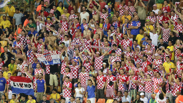 Croatia fans watch the group A World Cup soccer match between Cameroon and Croatia at the Arena da Amazonia in Manaus, Brazil, Wednesday, June 18, 2014. (AP Photo/Fernando Llano)