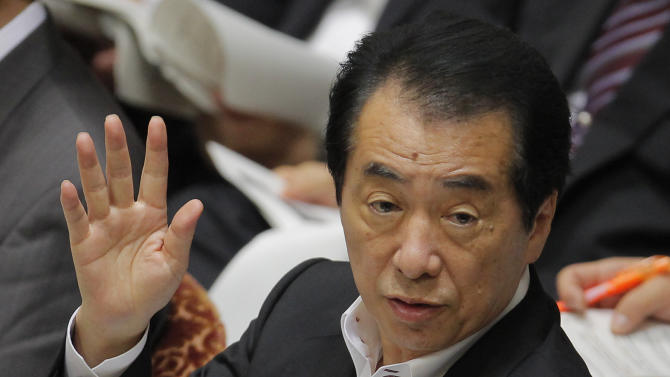 """Japan's Prime Minister Naoto Kan raises a hand before taking in an opposition lawmaker's questions during a question-and-answer session of the Lower House Budget Committee at the National Diet in Tokyo, Japan, Wednesday, July 6, 2011. Japan said Wednesday it will conduct """"stress tests"""" on all the country's nuclear plants to ease heightened concerns about disaster preparedness after this year's tsunami sparked the worst nuclear crisis since Chernobyl.(AP Photo/Itsuo Inouye)"""