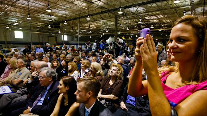 Employees of Colite International in Columbia, S.C. and supporters of Mitt Romney, listen as Romney speaks on shrinking federal government, repealing healthcare reform act and returning Medicaid to the states, at the facility Tuesday, Nov. 15, 2012. (AP Photo/The State, Tim Dominick)