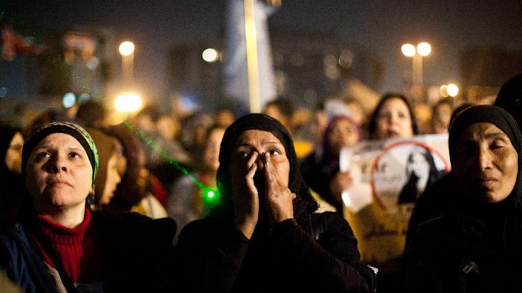 "Egyptian women gather to denounce sexual violence and harassment against women in Cairo, Egypt, Wednesday, Feb. 6, 2013. Mob-led sexual assaults targeting Egypt's female protesters could increase if perpetrators are not punished, an international rights group warned on Wednesday. Amnesty International said statements from victims show that the assaults follow a ""clear pattern,"" where mobs of men encircle the victims, assault them with weapons and hands and then try to undress them. Amnesty's warning followed a statement from the U.N. human rights office, which last week said that about 25 women were reportedly sexually assaulted — in some cases with extraordinary violence — in Cairo's Tahrir Square during recent demonstrations against Egypt's Islamist President Mohammed Morsi. (AP/Virginie Nguyen Hoang"
