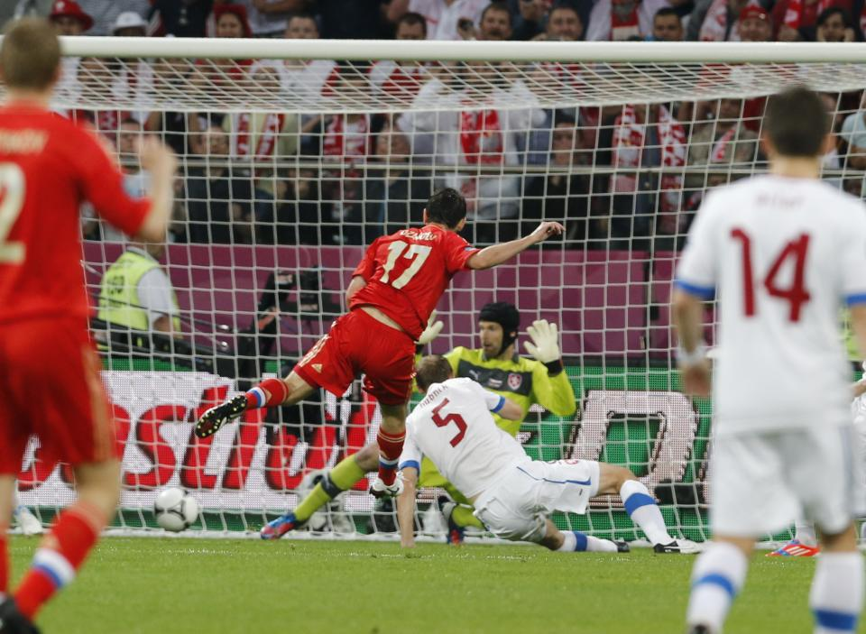 Russia's Alan Dzagoyev, center, scores a goal past Czech goalkeeper Petr Cech, yellow,  during the Euro 2012 soccer championship Group A match between Russia and Czech Republic in Wroclaw, Poland, Friday, June 8, 2012. (AP Photo/Antonio Calanni)