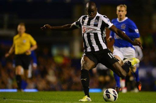 Newcastle United's Senegalese forward Demba Ba shoots