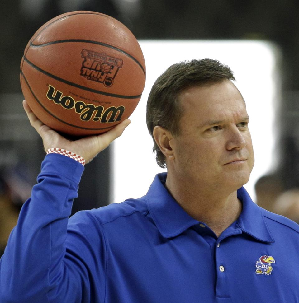 Kansas head coach Bill Self passes a ball during a practice session for the NCAA Final Four basketball tournament Friday, March 30, 2012, in New Orleans. Kansas plays Ohio State in a semifinal game on Saturday. (AP Photo/David J. Phillip)