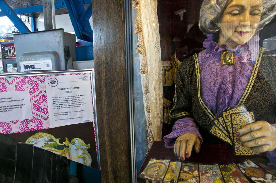 "This June 12, 2013 photo shows the 90-year-old fortune telling machine ""Grandma's Predictions,"" which was restored after damage in superstorm Sandy at the amusement park in the Coney Island neighborhood in the Brooklyn borough of New York. (AP Photo/Bebeto Matthews)"
