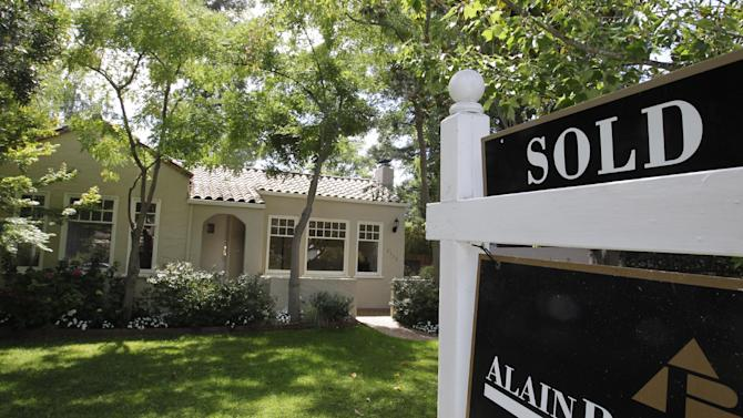 This Tuesday, Aug. 21, 2012, photo, shows an exterior view of a home sold in Palo Alto, Calif. A measure of U.S. home prices jumped 4.6 percent in August compared with a year ago, the largest year-over-year increase in more than six years. CoreLogic, a private real estate data provider, also said Tuesday that prices rose 0.3 percent in August from July, the sixth straight monthly gain. (AP Photo/Paul Sakuma)
