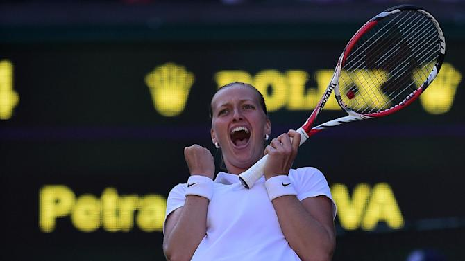 Czech Republic's Petra Kvitova celebrates winning her women's singles third round match against American Venus Williams on day five of the 2014 Wimbledon Championships at The All England Tennis Club in Wimbledon, southwest London, on June 27, 2014