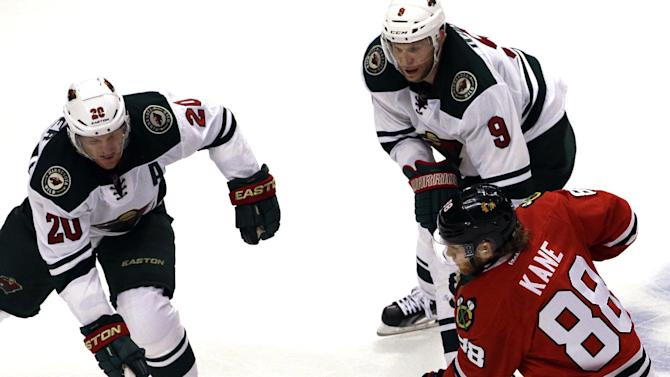 Power outage forces restoration of ice for Blackhawks-Wild