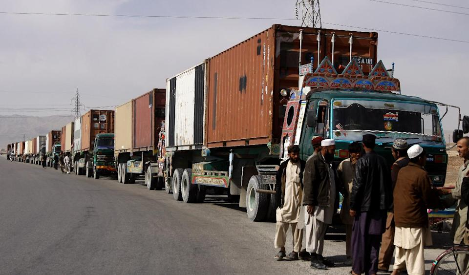 NATO truck drivers wait for authorization papers to travel to Karachi, Pakistan, at the Kuchlak checkpoint near Quetta Tuesday, Feb. 12, 2013. The U.S. says it has started using the land route through Pakistan to pull American military equipment out of Afghanistan. (AP Photo/Arshad Butt)