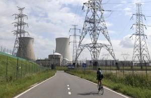 A man cycles towards Doel's nuclear plant