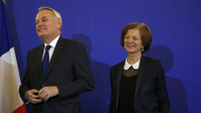Newly-appointed French Foreign Minister Jean-Marc Ayrault and his wife Brigitte attend a news conference during the official handover ceremony at the Quai d'Orsayin Paris
