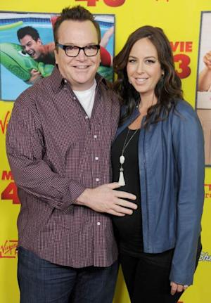 Tom Arnold and wife Ashley Groussman arrive at the 'Movie 43' Los Angeles premiere at Grauman's Chinese Theatre on January 23, 2013 in Hollywood -- Getty Premium