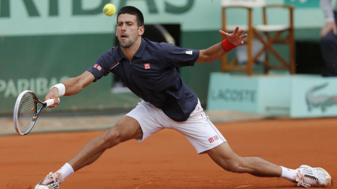 Novak Djokovic of Serbia returns in his fourth round match against Andreas Seppi of Italy at the French Open tennis tournament in Roland Garros stadium in Paris, Sunday June 3, 2012. Djokovic won in five sets 4-6, 6-7, 6-3, 7-5, 6-3. (AP Photo/Bernat Armangue)