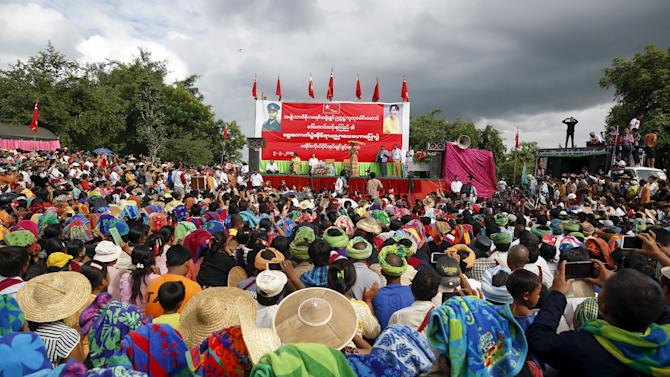 Myanmar pro-democracy leader Aung San Suu Kyi gives a speech on voter education at the Hsiseng township in Shan state, Myanmar
