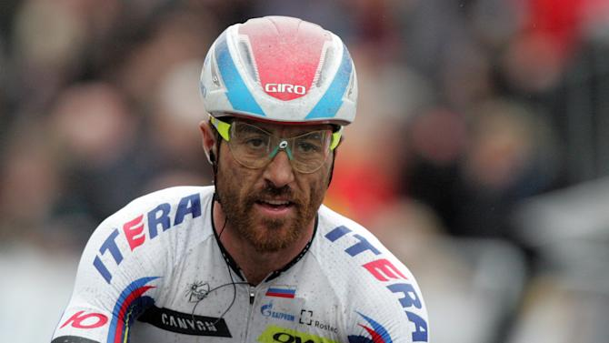 Luca Paolini, of the team Katusha sprints towards the finish line to win the Belgian cycling classic 'Ghent-Wevelgem', part of the UCI World Tour, in Wevelgem, western Belgium, Sunday, March 29, 2015. Niki Terpstra, of the team Etixx-Quick Step, placed second and Geraint Thomas, of the team Sky, placed third. (AP Photo/Francois Walschaerts)