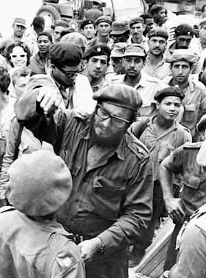 FILE - This April 1961 file photo shows Fidel Castro, center, with members of the Revolutionary Armed Forces at his base of operations at the Australia Sugar Refinery in Jaguey, near Playa Giron, during the Bay of Pigs invasion in April 1961. (AP Photo/Str)