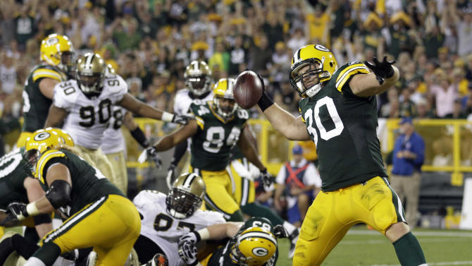 Green Bay Packers' John Kuhn celebrates after rushing for a touchdown during the second half of an NFL football game against the New Orleans Saints Thursday, Sept. 8, 2011, in Green Bay, Wis. The Packers won 42-34. (AP Photo/Morry Gash)