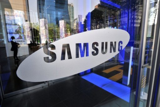 <p>File photo shows a Samsung Electronics logo in Seoul, South Korea. Samsung said Tuesday it had signed a deal to buy a mobile technology unit belonging to British firm Cambridge Silicon Radio (CSR) in a bid to improve its handheld devices.</p>