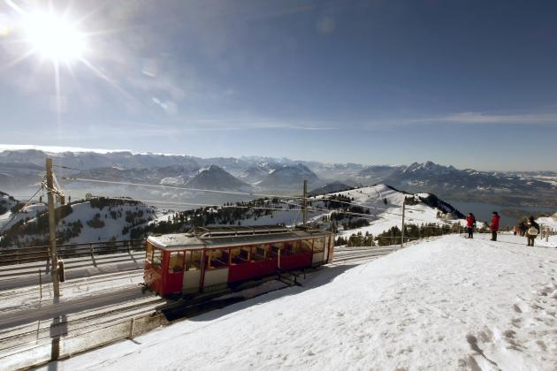 A rack railcar of Rigi Bahn railways leaves the peak of Mount Rigi near Lake Lucerne