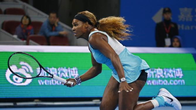 Williams of the U.S. runs for the ball during her women's singles match against Pironkova of Bulgaria at the China Open tennis tournament in Beijing