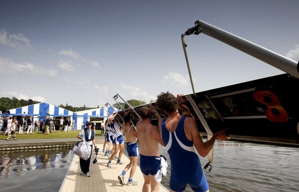 A crew lift their boat out of the water during the second day of the 2012 Henley Royal Regatta on June 28, 2012 in Henley-on-Thames, England. Held since 1839, this social and sporting event is a highl