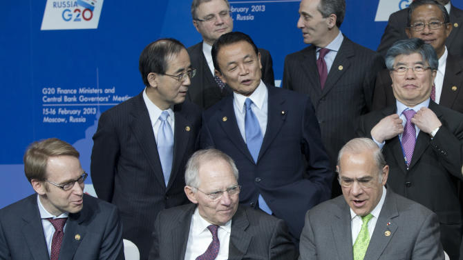 German Central Bank Governor Jens Weidmann, front left, German Finance Minister Wolfgang Schauble, front center, Governor of the Bank of Japan, Masaaki Shirakawa, rear left, talks with Japanese Finance Minister Taro Aso, center, and South Korea Central Bank Governor Kim Choong-soo, rear right, attend a group photo ceremony at a meeting of G20 Finance Ministers and Central Bank Governors in Moscow, Russia, Saturday, Feb. 16, 2013. (AP Photo/Misha Japaridze)