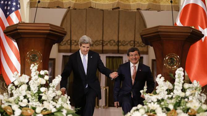 U.S. Secretary of State John Kerry, left, enters a news conference with Turkish Foreign Minister Ahmet Davutoglu at Ankara Palace in Ankara, Turkey, on Friday, March 1, 2013. Ankara is the fifth leg of Kerry's first official overseas trip, a nine-day dash through Europe and the Middle East. (AP Photo/Jacquelyn Martin, Pool)