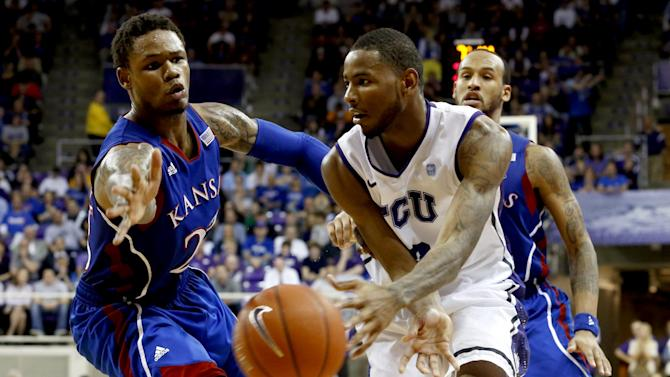 Kansas guard Ben McLemore, left, defends as TCU forward Connell Crossland passes the ball during the second half of an NCAA college basketball game, Wednesday, Feb. 6, 2013, in Fort Worth, Texas. TCU won 62-55. (AP Photo/Sharon Ellman)