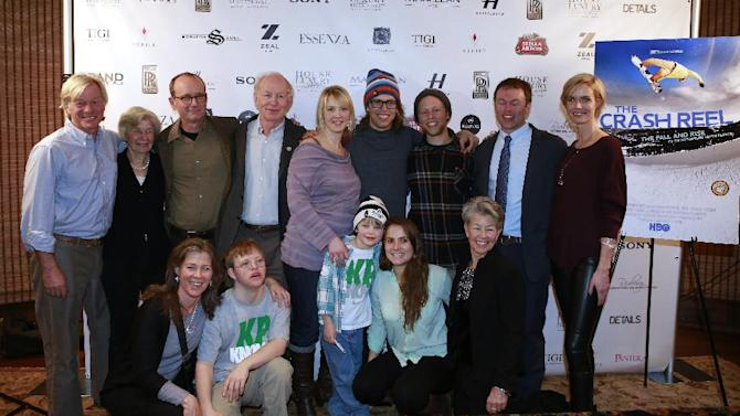 """IMAGE DISTRIBUTED FOR RAND LUXURY - Back row from left, Michael McDonnell, Peggy Walsh, Sam Harper, Simon Pearce, Dr. Holly Ledyard , Kevin Pearce, Adam Pearce, Andrew Pearce,Whitney Pratt, and front row from left, Anna McDonnell, David Pearce, Max Ledyard, Kyla Donnelly, Pia Pearce from the film """"The Crash Reel"""" are seen at Resorts West House of Luxury, on Monday, Jan. 21, 2013 in Deer Valley, Utah. (Photo by Benjamin Cohen/Invision for Rand Luxury/AP Images)"""
