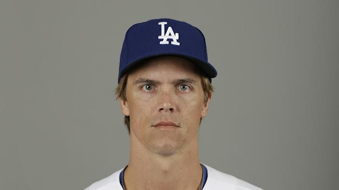 This is a 2013 photo of Los Angeles Dodgers pitcher Zack Greinke. This image reflects the Los Angeles Dodgers baseball team active roster when this image was taken in Phoenix, Sunday, Feb. 17, 2013.  Greinke was scratched from his spring training start for the Dodgers on Monday March 11, 2013, against Milwaukee and went to Los Angeles to have his sore right elbow examined. Greinke, signed to a $147 million, six-year contract in December as a free agent, threw a bullpen session Friday without issue, then felt discomfort while throwing Sunday.  (AP Photo/Paul Sancya)