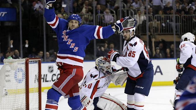New York Rangers right wing Ryane Clowe (29) celebrates a goal scored by left wing Carl Hagelin in the second period of Game 4 of their first-round NHL hockey Stanley Cup playoff series against the Washington Capitals in New York, Wednesday, May 8, 2013.  (AP Photo/Kathy Willens)