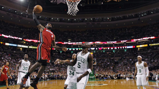 Miami Heat forward LeBron James (6) elevates for a dunk past Boston Celtics' Brandon Bass (30), Paul Pierce (34), Kevin Garnett (5) and Rajon Rondo (9) during the first half in Game 6 of the NBA basketball Eastern Conference finals, Thursday, June 7, 2012, in Boston. (AP Photo/Charles Krupa)