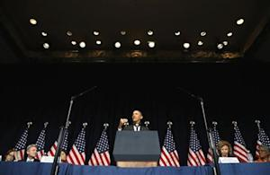 Obama addresses the winter meeting of the Democratic National Committee in Washington