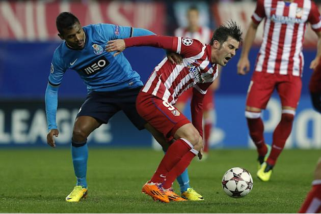 Atletico's David Villa, right, in action with Porto's Alex Sandro, left, during a Champions League Group G soccer match between Atletico Madrid and FC Porto, at the Vicente Calderon stadium in