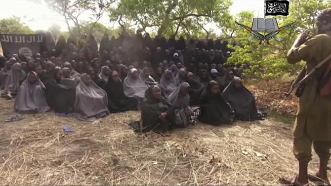 FILE - This file photo taken from video by Nigeria's Boko Haram terrorist network on Monday, May 12, 2014, shows the missing girls alleged to be abducted on April 14 from the town of Chibok in northeastern Nigeria. Freeing the 276 Nigerian girls from the terrorist group Boko Haram is now one of the U.S. government's top priorities, U.S. officials declared on Thursday, May 15, issuing warnings about the militant group's expanding reach and growing capacity for more sophisticated and deadlier terror attacks. (AP Photo/File)