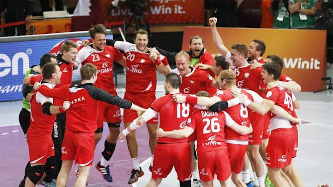 . Lusail (Qatar), 01/02/2015.- Polish players celebrate after winning the Qatar 2015 24th Men's Handball World Championship bronze medal match between Poland and Spain at the Lusail Multipurpose Hall outside Doha, Qatar, 01 February 2015. Qatar 2015 via epa/Ali Haider Editorial Use Only/No Commercial Sales
