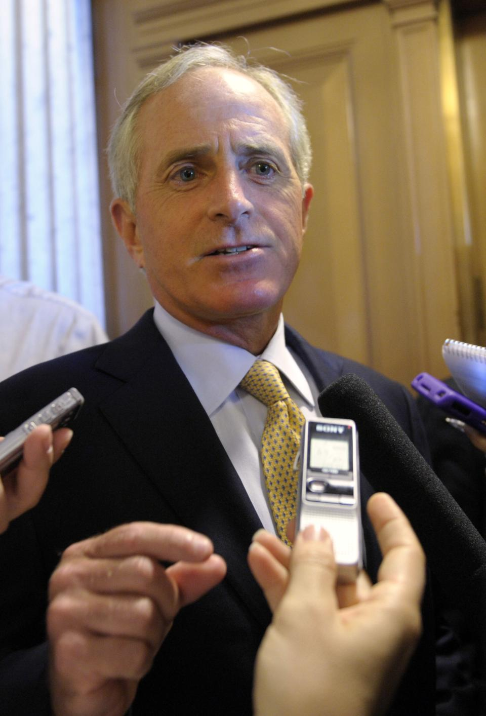 Sen. Bob Corker, R-Tenn., talks with reporters on Capitol Hill in Washington, Sunday, July 31, 2011, as the debt showdown continues. (AP Photo/Susan Walsh)