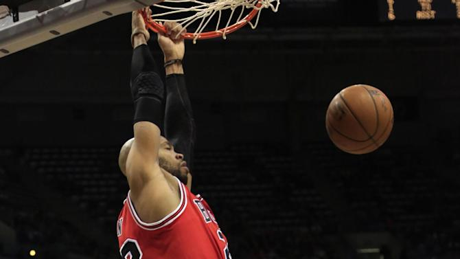 Chicago Bulls forward Taj Gibson, front, dunksagainst the Milwaukee Bucks during the first half of an NBA basketball game Wednesday, April 1, 2015, in Milwaukee. (AP Photo/Darren Hauck)