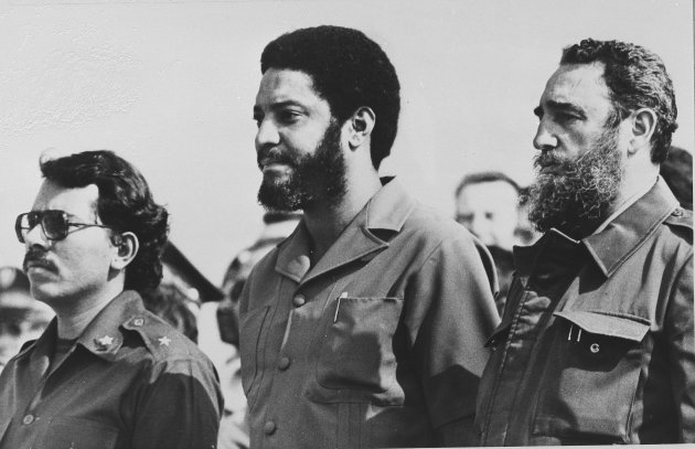 In this May 1, 1980 file photo, then Grenada's Prime Minister Maurice Bishop, center, is flanked by Cuba's leader Fidel Castro, right, and Nicaragua's President Daniel Ortega in Havana, Cu