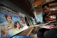 Books written in the Shan language sit on a shelf at a library in Taunngyi, capital of Myanmar&#39;s northeastern Shan state. For half a century a single precious copy of a Shan language textbook has kept the Myanmar ethnic minority dialect alive for generations of students, forced to learn in the shadows under a repressive junta