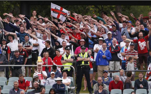 England supporters cheer during the fifth day's play in the second Ashes cricket test between England and Australia at the Adelaide Oval