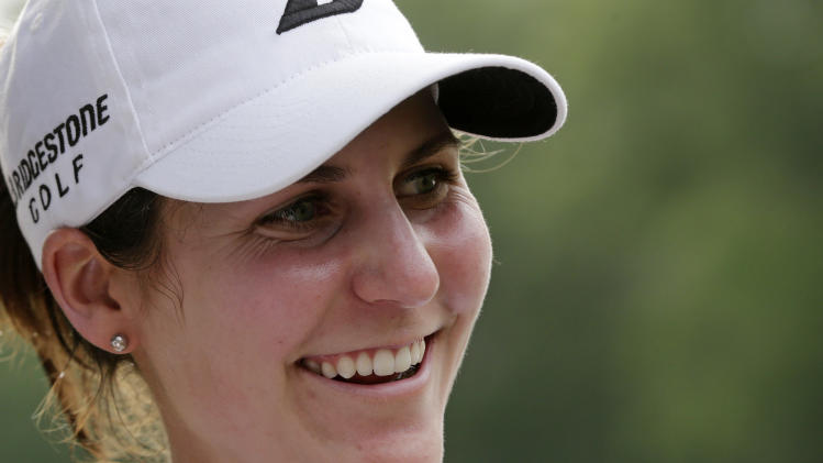 Jennifer Johnson is all smiles after winning the Mobile Bay LPGA Classic golf tournament at the Robert Trent Jones Golf Trail at Magnolia Grove in Mobile, Ala. Sunday, May 19, 2013. (AP Photo/Dave Martin)