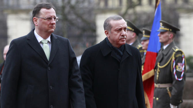 Czech Republic's Prime Minister Petr Necas, left, welcomes his Turkish counterpart Recep Tayyip Erdogan, right, with military honors at the government's headquarters in Prague, Czech Republic, Monday, Feb. 4, 2013. (AP Photo/Petr David Josek)