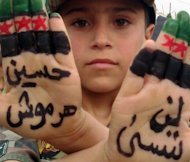 A picture from the Syrian opposition's Shaam News Network shows a boy with his fingers painted in the colours of Syria's pre-Baath national flag during an anti-regime demonstration in Dael, near the border with Jordan