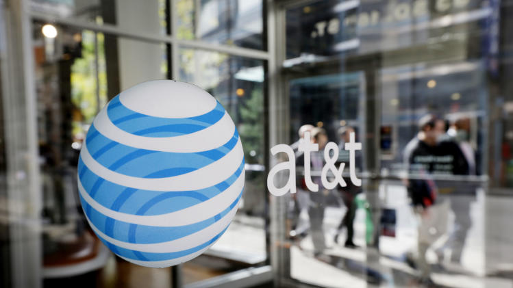 FILE - In this Wednesday, Oct. 17, 2012, file photo, an AT&T logo is displayed on an AT&T Wireless retail store front, in Philadelphia. The country's second-largest cellphone carrier says it's introducing an option called AT&T Next on July 26, 2013. Instead of paying, for example, $200 up front to buy a smartphone, customers would pay monthly installments of $15 to $50 on top of their service plan, depending on the device. (AP Photo/Matt Rourke, File)